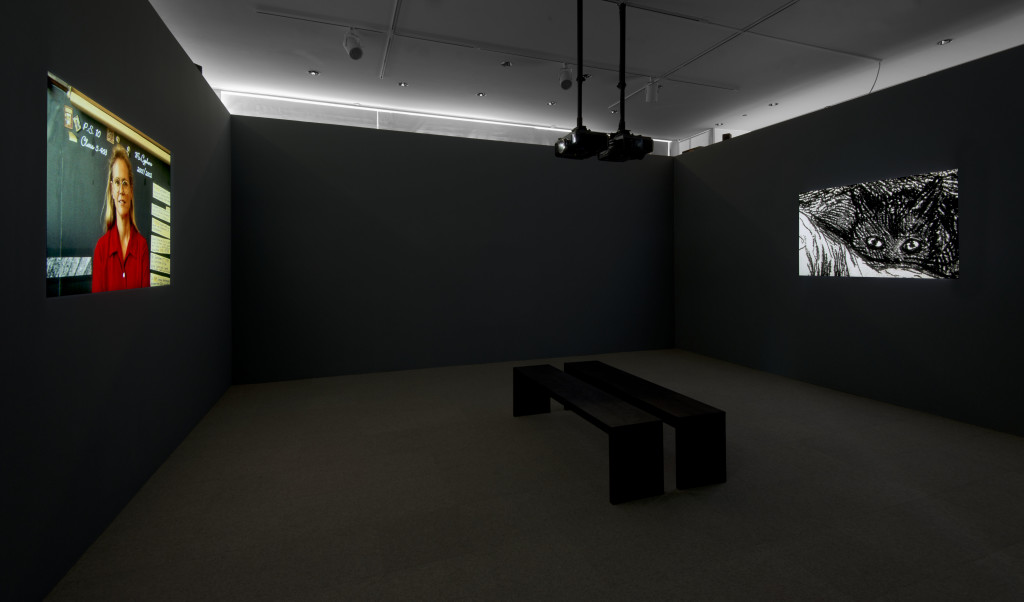 Proximity to Power, American Style, 2003/2004. 91 slides, 2 projectors, continuous projection,audio loop, 37:00. Installation view, Hammer Museum, 2014.